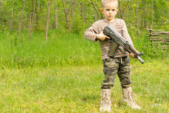 Small boy playing with a gun Stock Photos