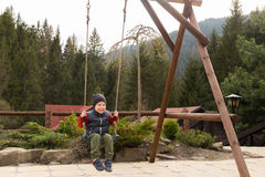 A small boy playing on the seesaw Royalty Free Stock Photography