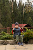 A small boy playing on the seesaw Royalty Free Stock Image