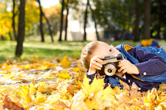 Small boy playing with a slr camera Stock Photography