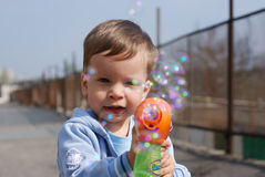 Small boy playing with soap bubbles Royalty Free Stock Images