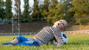 Small boy playing with a soccer ball Royalty Free Stock Image