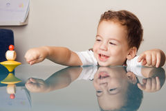 Small boy is playing with a toy Stock Images