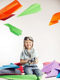 Small boy playing toy plane royalty free stock image