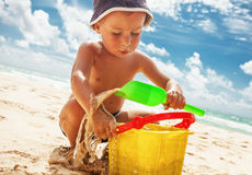 Small boy playing with toys on the beach Stock Photography