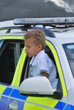Small boy playing in UK Police Car Royalty Free Stock Photography
