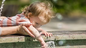 Small Boy Playing With Water In Fountain Stock Photo