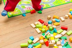 Small boy playing with wooden blocks Stock Images