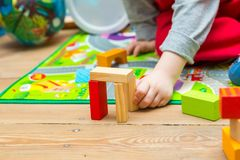Small boy playing with wooden blocks Stock Photos