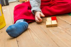Small boy playing with wooden blocks Royalty Free Stock Images