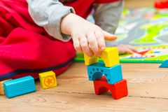 Small boy playing with wooden blocks Royalty Free Stock Photos