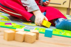 Small boy playing with wooden blocks Stock Photo