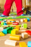Small boy playing with wooden blocks Royalty Free Stock Image