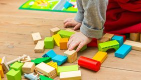 Small boy playing with wooden blocks Royalty Free Stock Photography