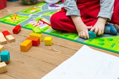 Small boy playing with wooden blocks Stock Photography