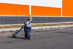 Small boy plays outdoors Royalty Free Stock Photos