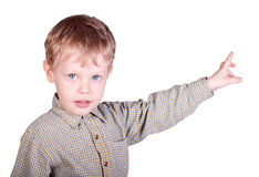 Small boy pointing forward Royalty Free Stock Photos