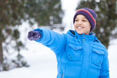 Small boy pointing at someone and smiling. Stock Photos