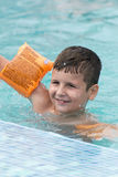 Small boy in the pool Stock Images