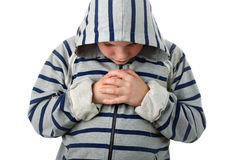 Small boy praying before the sports match isolated Royalty Free Stock Images