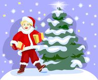 Small boy with presents. With christmas tree on background Stock Photos