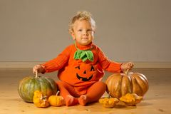 Small boy in pumpkin costume posing at studio.  royalty free stock images