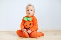 Small boy in pumpkin costume posing at studio.  royalty free stock image