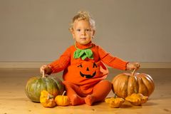Small boy in pumpkin costume posing at studio.  royalty free stock photography