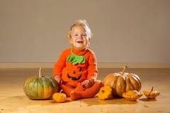 Small boy in pumpkin costume posing at studio.  royalty free stock photo
