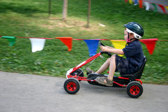 Small Boy Racing Pedal Kart Stock Photo