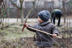 Small boy with rake Royalty Free Stock Images