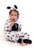 Small boy with red lolipop. Sitting on the floor Stock Photos