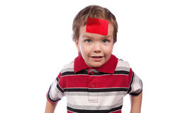 Small boy with red tape on their foreheads Royalty Free Stock Image