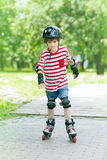 Small boy on rollers Stock Photo