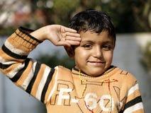 A small boy saluting Royalty Free Stock Photos