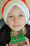 Small boy in Santa hat. Child in Santa hat with Christmas present in his hands stock image