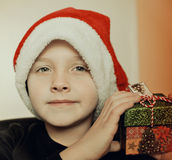 Small boy in Santa hat. Child in Santa hat with Christmas present in his hands stock images