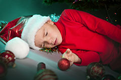 Small boy in santa hat sleep Royalty Free Stock Photography