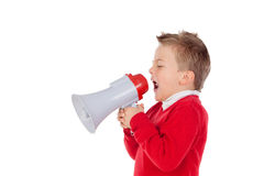 Small boy shouting through a megaphone Royalty Free Stock Images