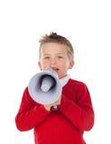 Small boy shouting through a megaphone Royalty Free Stock Photos