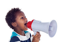 Small boy shouting through a megaphone Royalty Free Stock Photography
