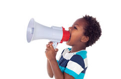 Small boy shouting through a megaphone Royalty Free Stock Image