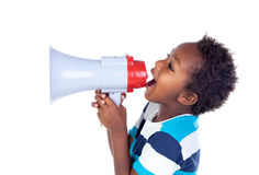Small boy shouting through a megaphone Royalty Free Stock Photo
