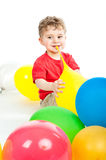Small boy sits around balloons Royalty Free Stock Photos