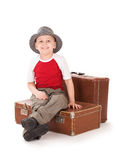 Small  boy sits on a suitcase. Stock Photo