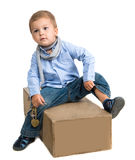 Small  boy sitting on a box Royalty Free Stock Photos