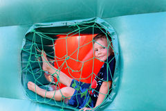 Small boy sitting in window of bouncy castle Royalty Free Stock Photography