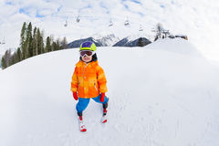Small boy in ski mask and helmet skiing alone Stock Photo