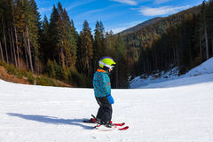 Small boy in ski mask standing and skiing Royalty Free Stock Images