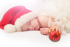 Small boy sleeping in a New Year's cap stock image